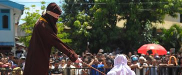 Man, Woman, Illicit relationship, Extramarital affair, Love affair, Jakarta, Woman man publicly caned, Indonesia, World news